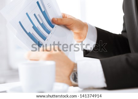 picture of businessman on meeting discussing graphics