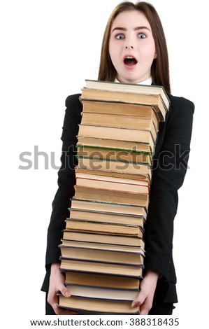 Picture of businesswoman holding a lot of books, isolated on white background - stock photo