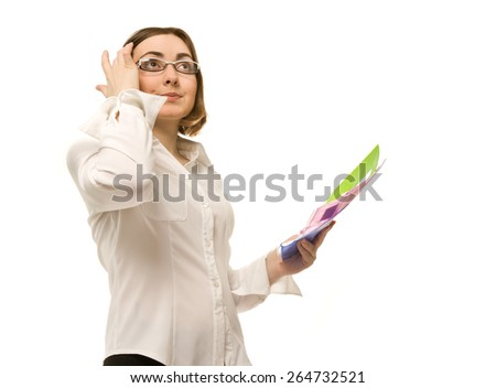 Picture of businesswoman holding colorful folders and looking up - stock photo