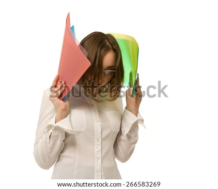 Picture of businesswoman holding colorful folders and screaming - stock photo