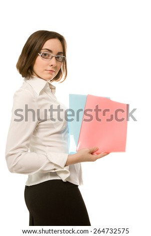 Picture of businesswoman in white demonstrating blue and red folders - stock photo