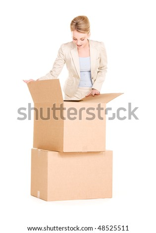 picture of businesswoman with boxes over white - stock photo