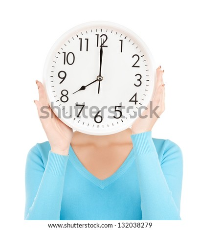 picture of businesswoman with clock over her face - stock photo