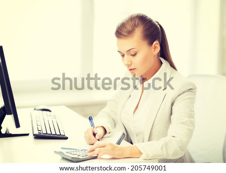 picture of businesswoman with notebook and calculator