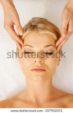 picture of calm beautiful woman in massage salon - stock photo