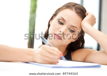 picture of calm woman with big notepad - stock photo