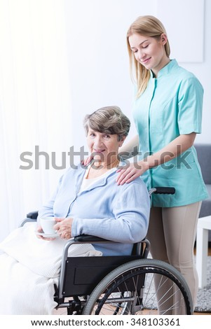 Picture of carer supporting old woman with health afflictions