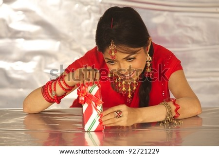 picture of cheerful asian girl with gift box - stock photo