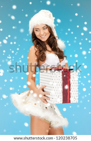 picture of cheerful santa helper girl in lingerie with gift box