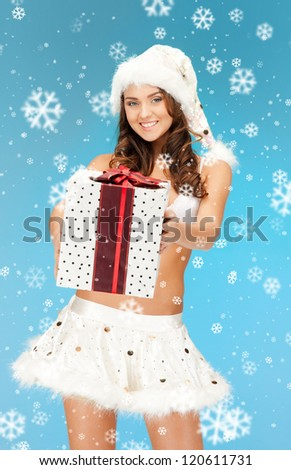 picture of cheerful santa helper girl in lingerie with gift box - stock photo