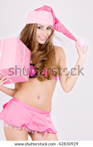 picture of cheerful santa helper girl with gift box - stock photo
