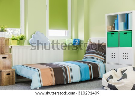 Picture of colorful sleeping area in teenager room - stock photo