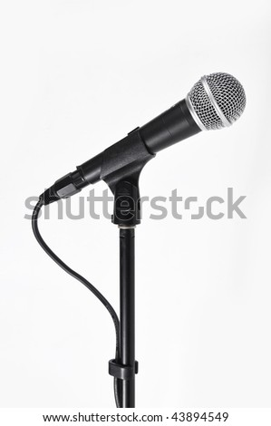 Picture of concerto microphone with a cord on a white background