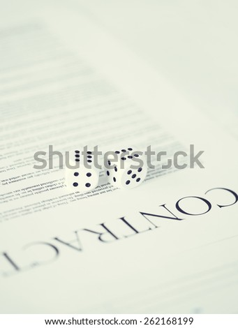 picture of contract paper with gambling dices - stock photo