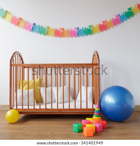 Picture of cosy baby room with simple bed - stock photo