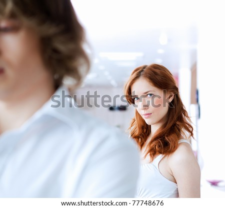 picture of couple in disagreement at home in the living room - stock photo