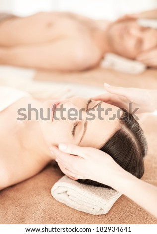 picture of couple in spa salon getting face treatment