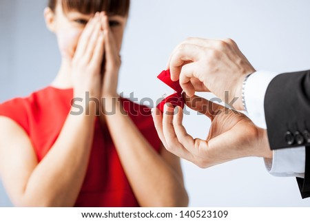 picture of couple with wedding ring and gift box - stock photo