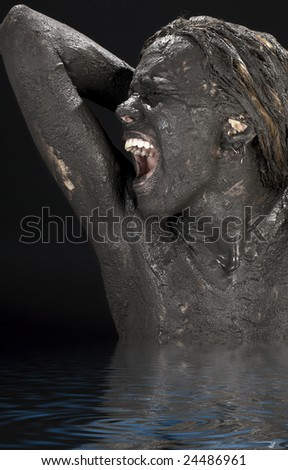 picture of crying dirty woman in water - stock photo