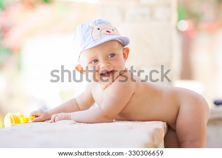 Picture of cute baby playing outdoors, love and happiness concept - stock photo