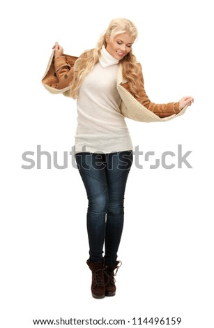 picture of dancing woman in sheepskin jacket - stock photo