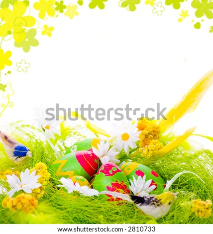 Picture of Decorative eggs in the nest and framed rendered flowers - stock photo