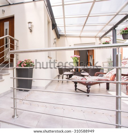 Picture of detached house with cozy patio - stock photo