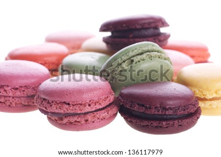 Picture of different colored macaroons on a white isolated background - stock photo