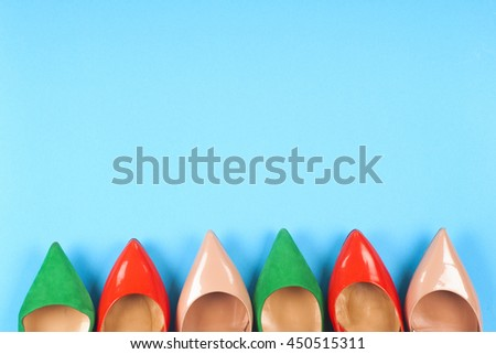 Picture of different leather shoes on light blue background. Copy space for text. - stock photo