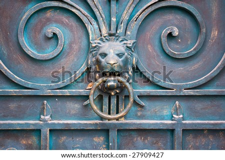 picture of dirty dooor with lion and knocker - stock photo
