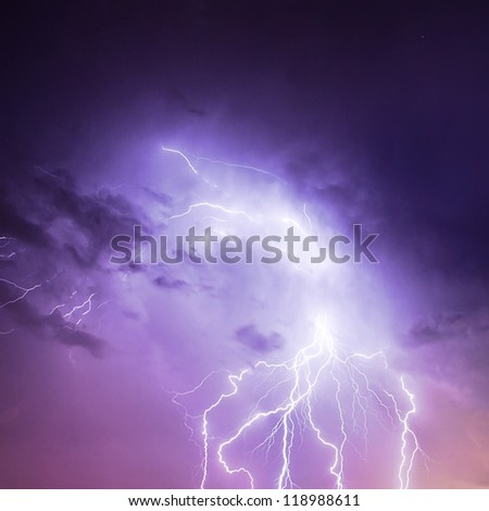 Picture of discharge lightning in cloudy purple sky, abstract natural background, thunderstorm in the rainy night, thunder and zipper, powerful electrical charge in dark blue skyscape, autumn weather - stock photo