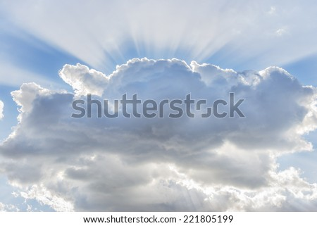 Picture of dramatic cloud with sunbeams in the sky - stock photo