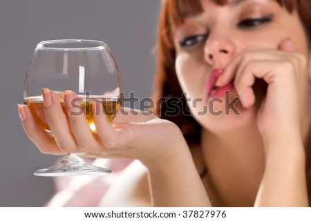 Picture of dreamy relaxing woman with wine glass