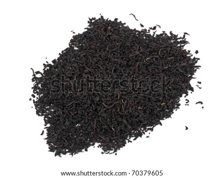 Picture of dry aromatic black tea leafs on white background - stock photo