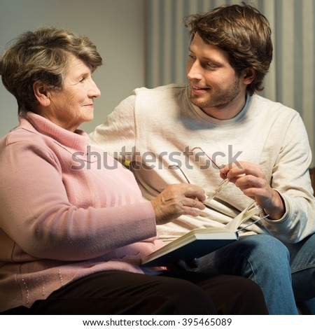 Picture of elderly female with health problem and her carer - stock photo