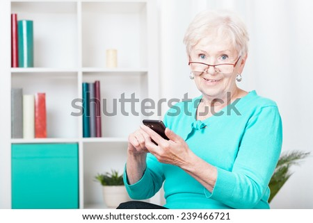 Picture of elderly woman using her smartphone - stock photo