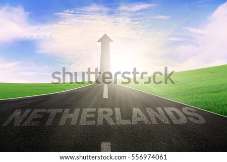 Picture of empty asphalt way with word of Netherlands and arrow upward
