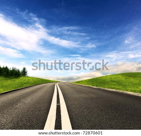 Picture of empty countryside road - stock photo