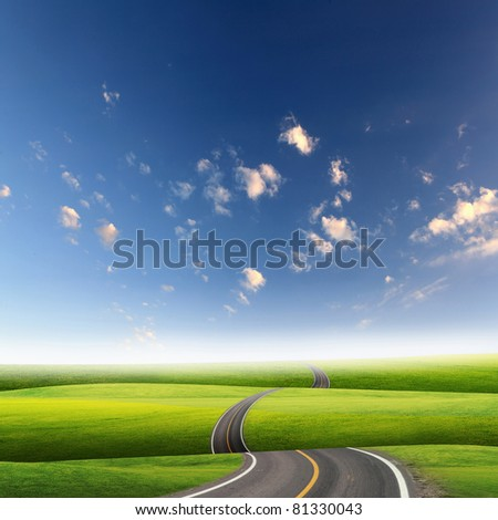 picture of empty road leading toward horizon and cloudy sky - stock photo
