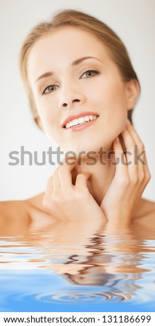 picture of face and hands of beautiful woman in water - stock photo
