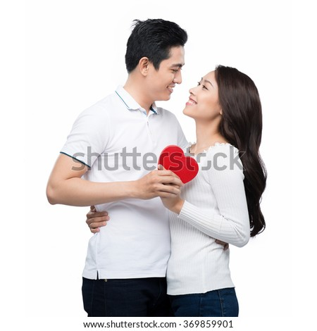 picture of family couple in a sweaters with heart. Beautiful young love couple embracing against a white background - stock photo