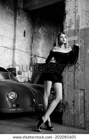 picture of fashionable woman in retro garage - stock photo