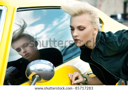 picture of fashionable woman with yellow car