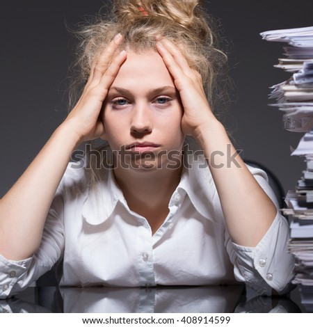 Picture of female bookkeeper and job burnout - stock photo