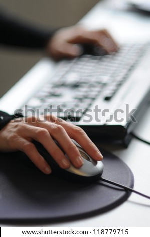 Picture of female hand on computer mouse