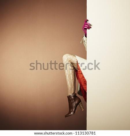 Picture of female legs in the interior. Conceptual fashion photo - stock photo