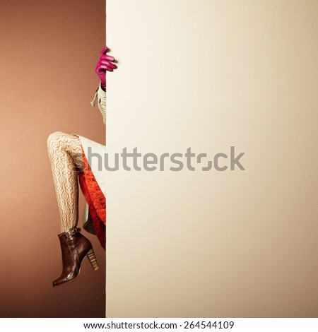 Picture of female legs in the interior. Conceptual fashion photo. Text background - stock photo