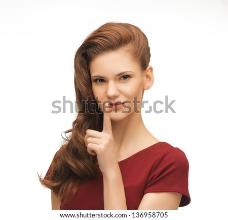 picture of flirting woman showing silence gesture - stock photo