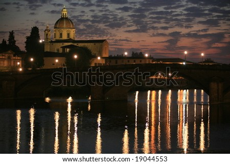 Picture of Florence Italy at dusk looking across the Arno river. - stock photo