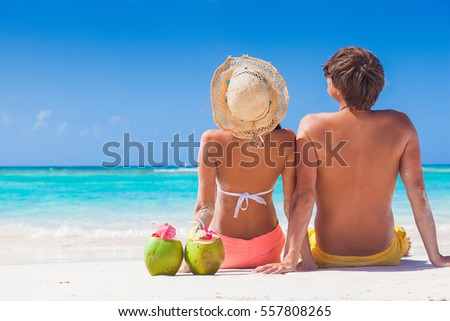 picture of fresh coconut juice and sunglasses on tropical beach